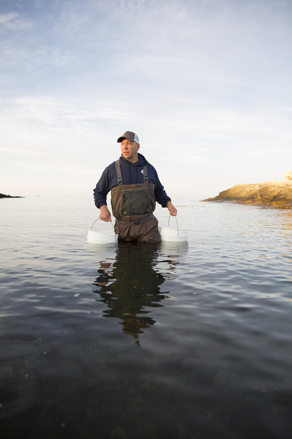Matt gathers bucket of seawater.